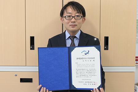 学会奨励賞を受賞した歯学部の土門久哲准教授